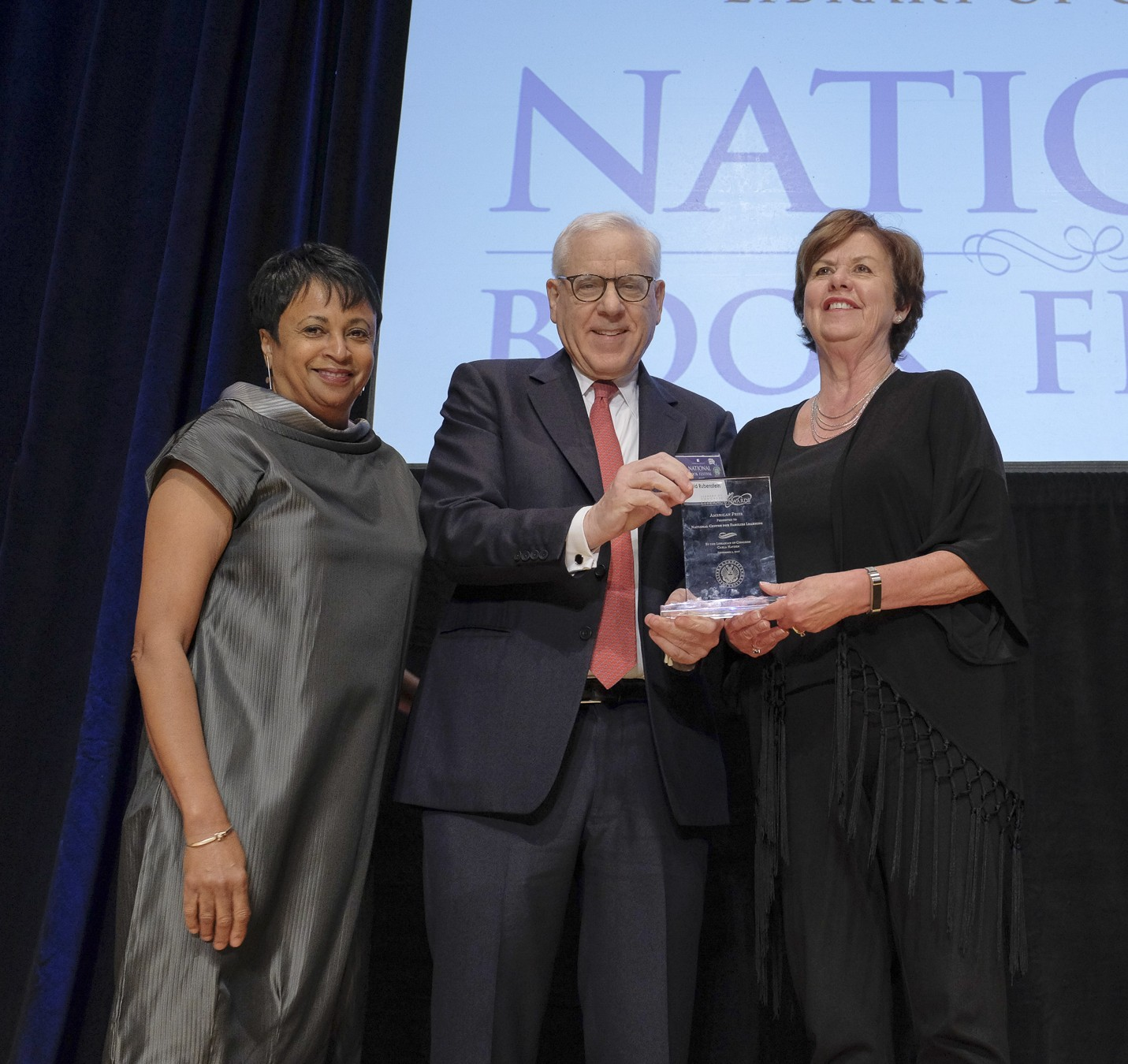 Librarian of Congress Carla Hayden and Literacy Awards benefactor David Rubenstein award the 2017 American Prize to the National Center for Families Learning from Louisville, Kentucky, during the National Book Festival Gala, September 1, 2017. Photo by Shawn Miller.