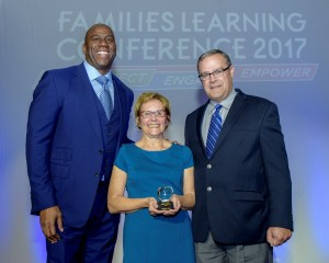"2017 Toyota Family Teacher of the Year Mary Andrews accepts the award from Earvin ""Magic"" Johnson, SodexoMAGIC and Mike Goss, general manager, Toyota Social Innovation"