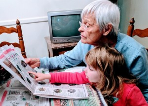 Grandparent and child reading